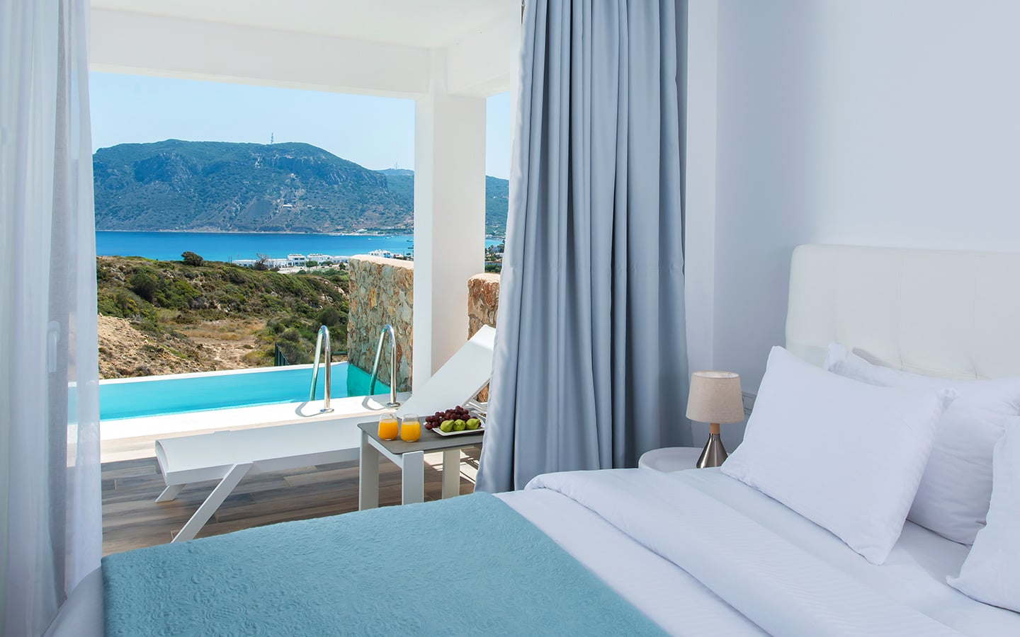 Double bed by the window overlooking the amazing view of Aegean Sea.