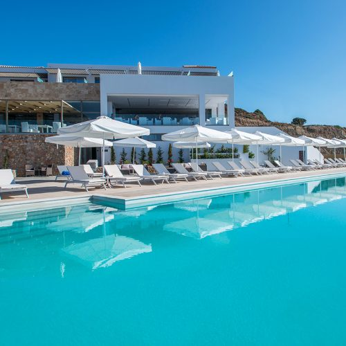 The sky is blue and the water of the pool light-blu at luxury hotel in Kos.