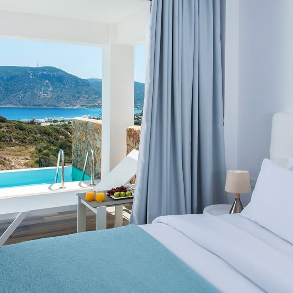 Double bed by the window overlooking the pool and the Aegan Sea in White Rock of Kos.