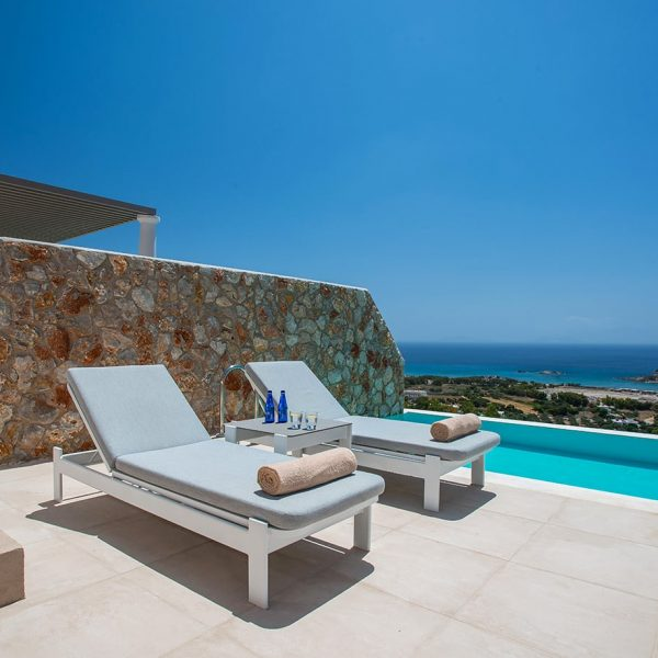 Two sunbeds near the pool in Signature Private Pool Suite in White Rock of Kos.