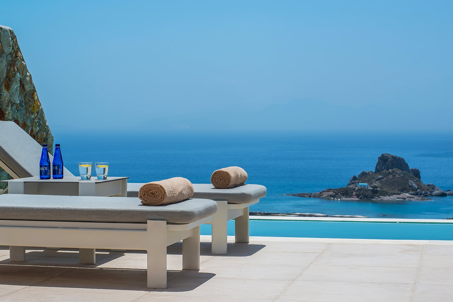 Towels on two sun loungers by the private pool of Signature Private Pool Suite in White Rock of Kos.