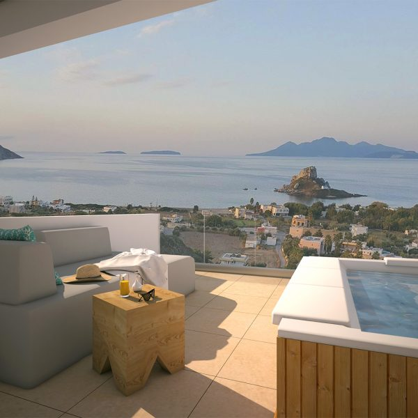 Sofa and outdoor jacuzzi at the private balcony of Suite with jacuzzi in Kos.
