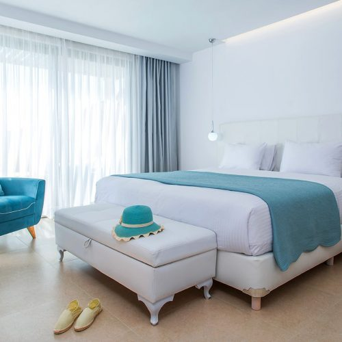 The luxury bedroom of Upbeat Outdoor Jacuzzi Suite With Sea View.